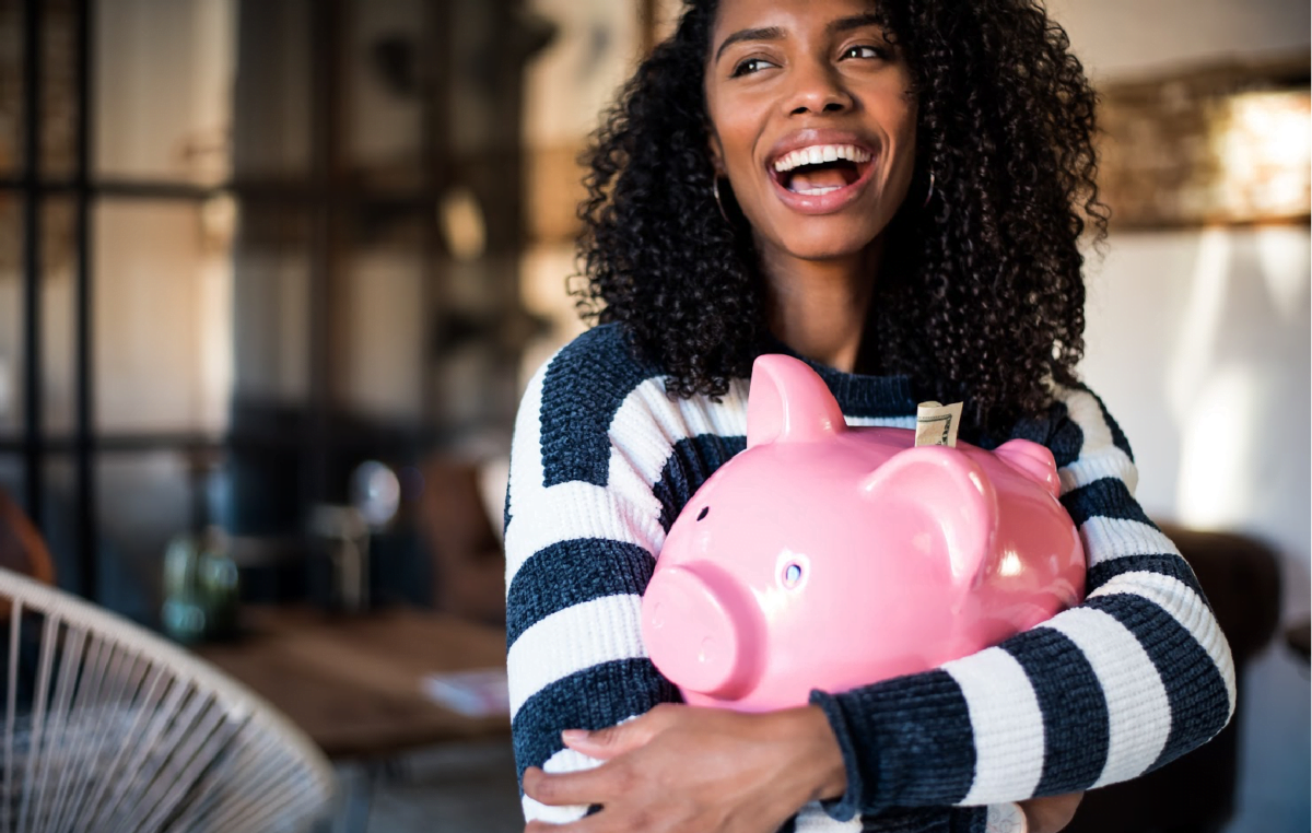 woman holding piggy bank income streams